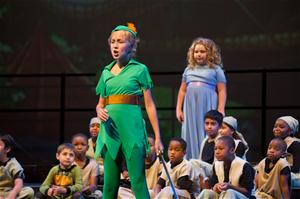 Kids putting on a Peter Pan stage production with Peter Pan and Wendy