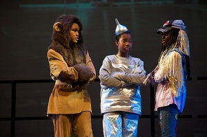 Kids putting on a stage production of Wizard of Oz with the Lion, Tin Man and Scarecrow